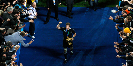New Zealand All Blacks captain Richie McCaw leaves the field with the Webb Ellis Cup after winning the final of the RWC 2011 against France at Eden Park Auckland. Photo / Richard Robinson