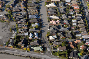 Aerial view of liquefaction and earthquake damaged houses in Burwood, Christchurch. Photo / Geoff Sloan.