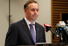 Prime Minister John Key doesn't think much of the Greens' plan to lower the dollar by printing more money. Photo / NZ Herald