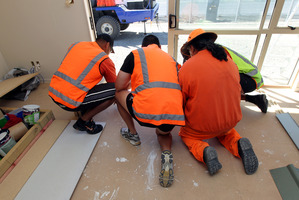 At Hawkes Bay Prison, inmates helped to build a house for Habitat. A crane later moved the building, in two parts, over the jail fence. Photo / APN