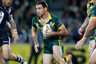 Australian Cameron Smith makes a break against New Zealand's during a rugby league Four Nations tournament, Eden Park, Auckland.Photo / AP