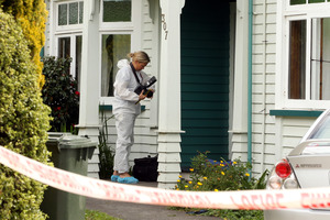 Police and forensic staff are investigating a fatal stabbing in Hastings. Photo / APN