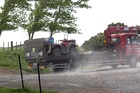 A truck removes a quad bike from a farm when a 10-year-old boy died today. Photo / APNZ