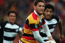 Tawera Kerr-Barlow of Waikato looks to pass the ball out during the ITM Cup round 15 rugby match between Waikato and Hawke's Bay. Photo / Getty Images.