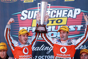 Paul Dumbrell and Jamie Whincup drivers of the #1 Team Vodafone Holden hold aloft the Peter Brock Trophy after winning the Bathurst 1000. Photo / Getty Images.