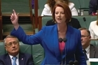 Prime Minister Julia Gillard Wednesday defended calling Australia's opposition leader a misogynist in a speech which sparked global attention and a divisive reaction about the role of sexism in politics.