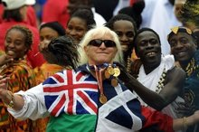 Jimmy Savile with people representing Commonwealth countries at  Buckingham Palace during the Golden Jubilee celebrations. Photo / AFP