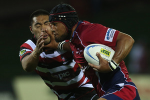 Tevita Koloamatangi of Tasman fends off Tyrone Lefau of Counties Manukau. Photo / Getty Images