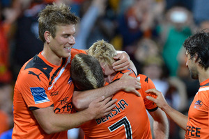 Besart Berisha and Mitchell Nichols of the Roar celebrate a goal during the round 2 A-League match between Brisbane Roar and Melbourne Victory. Photo / Getty Images
