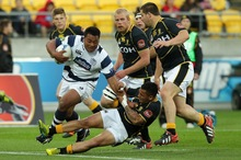 Pauliasi Manu of Auckland is tackled by Wellington's Frae Wilson. Photo / Getty Images