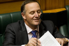 Prime Minister John Key takes his seat after reading his statement to the House, correcting what he said about the GCSB's involvement with Kim Dotcom. Photo / Mark Mitchell.