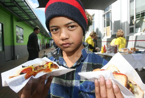 Peter Hing, 9, of Masterton with free sausages from the Mental Health Awareness Week free sausage sizzle in Queen Street, Masterton.