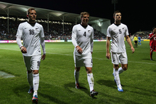 Jeremy Brockie, Ben Sigmund and Tommy Smith of the All Whites leave the pitch after one of the floodlights went out during the 2014 FIFA World Cup Qualifier match. Photo / Getty Images.