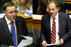 John Key reads his statement to the House. David Shearer on the attack during question time. Photos / Mark Mitchell