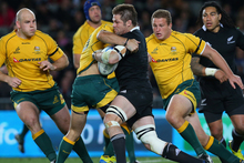 Richie McCaw of the All Blacks is tackled during The Rugby Championship Bledisloe Cup match between the New Zealand All Blacks and the Australian Wallabies. Photo / Getty Images.