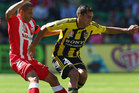 Luke Rowe of the Phoenix is challenged by Fred of the Heart during the round two A-League match between the Melbourne Heart and the Wellington Phoenix. Photo / Getty Images.