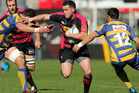Ryan Crotty of Canterbury breaks through tackles during the round 15 ITM Cup match between Canterbury and Bay of Plenty. Photo / Getty Images.