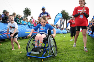 8-year-old Jaden Movold is cheered on to the finish line. Photo / Natalie Slade