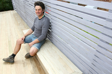 Justin Newcombe with the finished summer storage box/seat. Photo / Chris Gorman