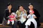 Dragon mums and babies (from left) Sara Xie with her daughter Eliza Xie (2 months), Eva Chen with son Arthur Wen (5 months) and Rae Ling with daughter Ally Tai (5 months). Photo / Natalie Slade