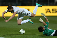 Chris Killen of the All Whites collides with goalkeeper Mikael Roche of Tahiti. Photo / Getty Images