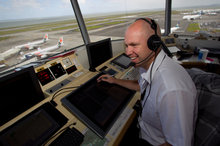 Steve Vaughan at his post in the Auckland Airport control tower from which he helps to oversee up to 44 landings and takeoffs an hour. Pho
