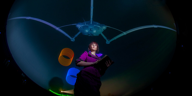 Melissa Nordhaus underneath the projection dome in War of the Worlds. Photo / Chris Loufte