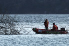 A surf lifesaving IRB is used to search. Photo / Alan Gibson