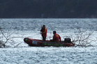 A surf lifesaving IRB is used in the search. Photo / Alan Gibson