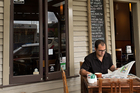The Porch Cafe in Waihi Beach village has a fire to relax by in winter, and a deck to soak up the sun in summer. Photo / Mike Hill Photography