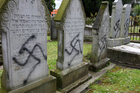 Jewish graves have been desecrated with Nazi emblems at the cemetery. Photo / Chris Gorman