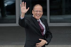 Philippines President Benigno Aquino III waves as he arrives for the Leaders Meeting at the APEC summit in Vladivostok, Russia, Saturday, Sept. 8, 2012. (AP Photo/Ivan Sekretarev)