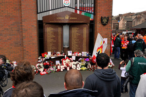 Floral tributes are laid for the Liverpool fans who died at Hillsborough. Photo / AP