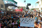 Anti-Syrian regime protesters wave the Syrian revolution flag at Sarmad, northern Syria. Photo / AP