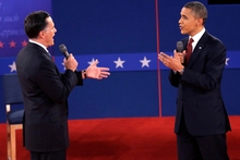 Republican presidential nominee Mitt Romney and President Barack Obama speak during the second presidential debate. Photo / AP 