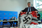 German police officers shows a Nazi flag confiscated from local neo-Nazis recently. Photo / AP