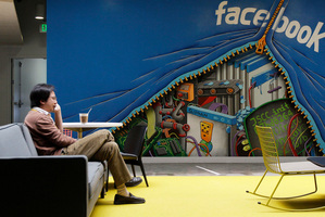 A glimpse inside the new Facebook office at Menlo Park in California's Silicon Valley, where a worker takes a break from the needs of 1 billion users. Photo / AP