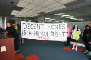 Protesters gather inside the Housing New Zealand office in Papakura recently. Photo / Chris Gorman