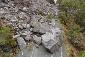 The Milford Road has been blocked by a slip that sent rocks - some the size of small cars - tumbling down a hill. Photo / supplied