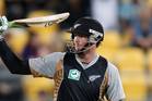 New Zealand's Martin Guptill raises his bat during a T 20 match against south Africa earlier this year. Photo / Mark Mitchell