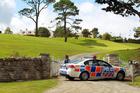 The police raid on Kim Dotcom's Coatesville mansion. Photo / Herald on Sunday