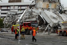 Fire service personnel were some of the first emergency services at the scene of the Pyne Gould Corporation building after the February earthquake. File photo  Simon Baker