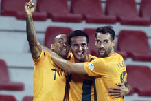 Tim Cahill, centre, celebrates after scoring against Iraq. Photo / AP
