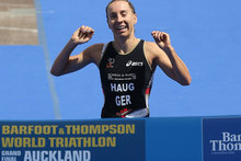Anne Haug of Germany crosses the finish line to w