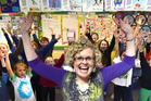 Winner of this year's most inspiring teacher award Jan Stevens celebrates with pupils from the soon-to-be-closed Rotary Park School. Photo / Peter McIntosh