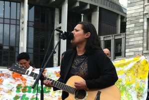 Anika Moa performs as part of the rally against child poverty. Photo / Kate Shuttleworth