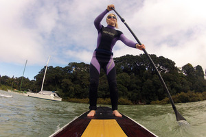 Rachel Grunwell tries paddleboarding at Little Shoal Bay on Auckland's North Shore. Photo / Getty Images