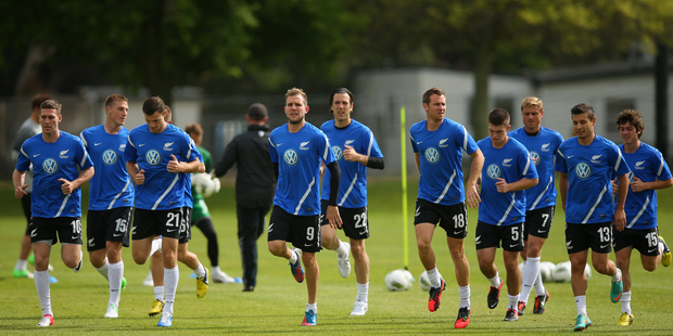 The New Zealand All Whites warm up for training in preparation for the game tomorrow in Christchurch. Photo / Getty Images