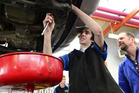 Otago Polytechnic automotive engineering student Issac Sonntag works on an oil change as part of the polytechnic's