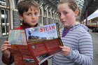 Hamish (9) and Kathryn (11) Milne, of Dunedin, wait in vain for the Ka 942 steam engine at Dunedin Railway Station. Photo / Craig Baxter.